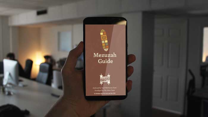 Mezuzah Guide on App in hand