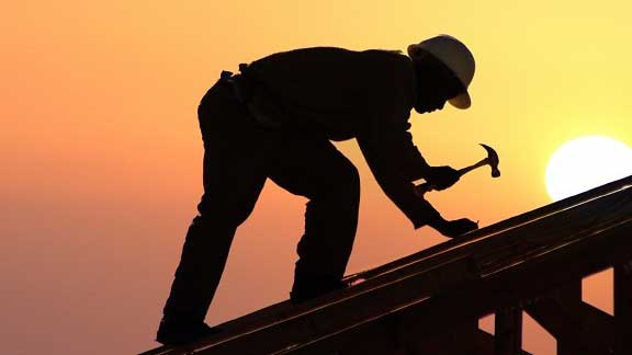 Roofer Working on Roof in Great Neck